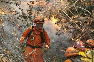 Wildfire destroys homes near Los Angeles, three...