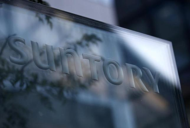 A signboard of Suntory Holdings is displayed at the entrance of Suntory World Headquarters in Tokyo January 14, 2014. REUTERS/Issei Kato