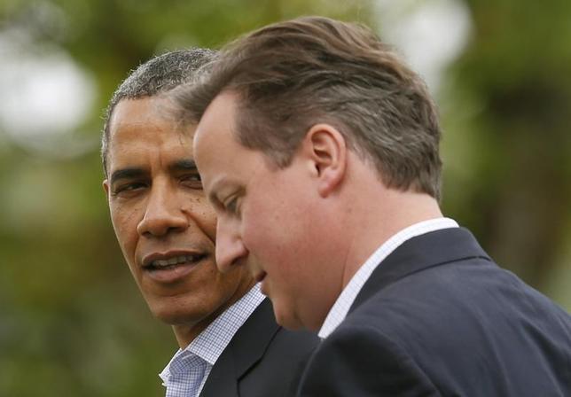 U.S. President Barack Obama walks with Britain's Prime Minister David Cameron during the G8 summit at the Lough Erne golf resort in Enniskillen, Northern Ireland June 18, 2013. REUTERS/Suzanne Plunkett