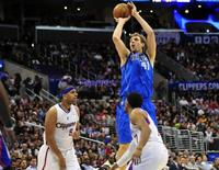 January 15, 2014; Los Angeles, CA, USA; Dallas Mavericks power forward Dirk Nowitzki (41) attempts a three point basket against the Los Angeles Clippers during the first half at Staples Center. Gary A. Vasquez-USA TODAY Sports