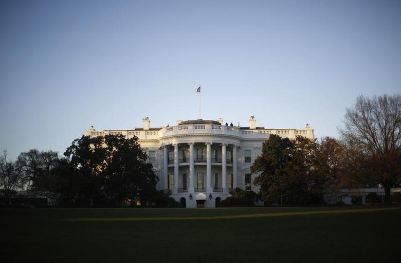 The White House is pictured at sunset in Washington, November 19, 2013. REUTERS/Jason Reed