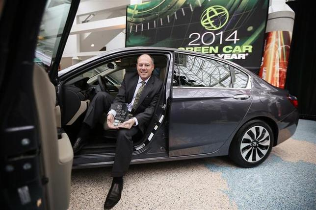 Mike Accavitti, senior vice president of automobile operations at American Honda, sits in the 2014 Honda Accord Hybrid, which was named ''Green Car of the Year'' at the Los Angeles Auto Show in Los Angeles, California, November 21, 2013. REUTERS/Lucy Nicholson/Files