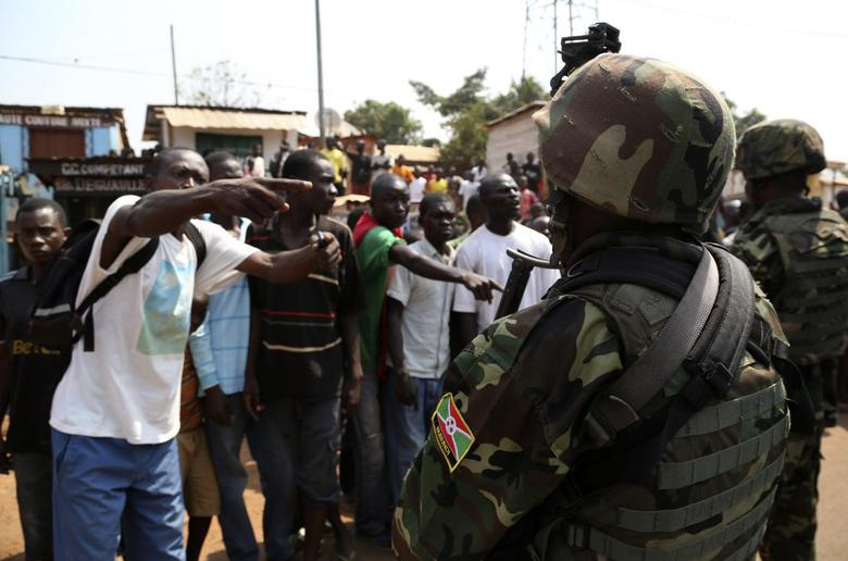 Angry men point at AU soldiers at Gobongo district in Bangui January 16, 2014. REUTERS/Emmanuel Braun