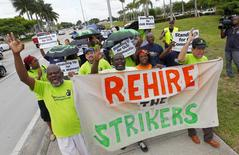 Walmart workers and supporters protest low wages outside one of the company's stores in Miami Gardens, Florida September 5, 2013. REUTERS/Joe Skipper
