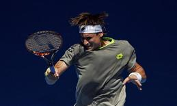 David Ferrer of Spain hits a return to Jeremy Chardy of France during their men's singles match at the Australian Open 2014 tennis tournament in Melbourne January 17, 2014. REUTERS/Jason Reed