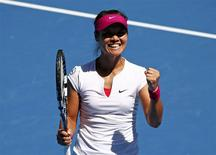 Li Na of China celebrates defeating Lucie Safarova of the Czech Republic during their women's singles match at the Australian Open 2014 tennis tournament in Melbourne January 17, 2014. REUTERS/David Gray