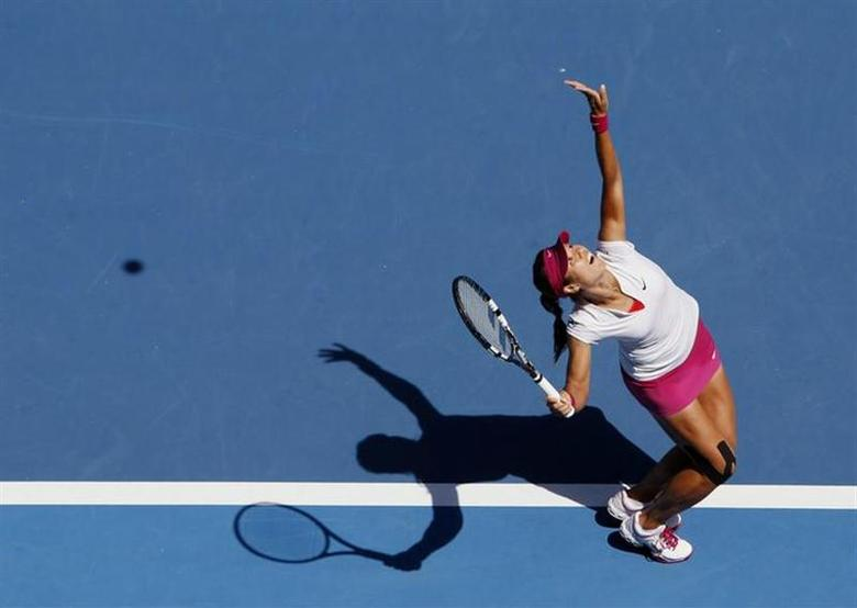 Li Na of China serves to Lucie Safarova of the Czech Republic during their women's singles match at the Australian Open 2014 tennis tournament in Melbourne January 17, 2014. REUTERS/Brandon Malone