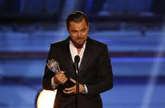 "Leonardo DiCaprio accepts the award for best actor in a comedy for ""The Wolf of Wall Street"" during the 19th annual Critics' Choice Movie Awards in Santa Monica, California January 16, 2014. REUTERS/Mario Anzuoni"