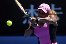 Serena Williams of the U.S. hits a return to Daniela Hantuchova of Slovakia during their women's singles matchat the Australian Open 2014 tennis tournament in Melbourne January 17, 2014. REUTERS/Petar Kujundzic