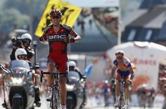 BMC Racing Team rider Alessandro Ballan (L) of Italy celebrates winning the last stage of the Eneco Tour cycling race in Geraardsbergen August 12, 2012. REUTERS/Francois Lenoir