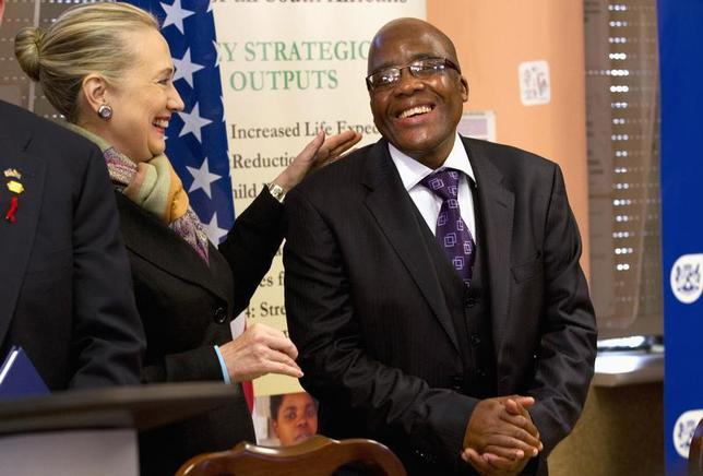U.S. Secretary of State Hillary Clinton talks with South Africa's Health Minister Aaron Motsoaledi after attending a PEPFAR (U.S. President's Emergency Plan for AIDS Relief) Transition Signing, at Delft South Clinic in Delft South, a suburb of Cape Town, August 8, 2012. REUTERS/Jacquelyn Martin/Pool
