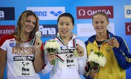 Gold medallist Liu Xiaoyu (C) of China poses with silver medallist Yulia Efimova (L) of Russia and bronze medallist Rebecca Ejdervik of Sweden during the women's 50m breaststroke final at the FINA Swimming World Cup in Dubai, October 8, 2011. REUTERS/Rabih Moghrabi