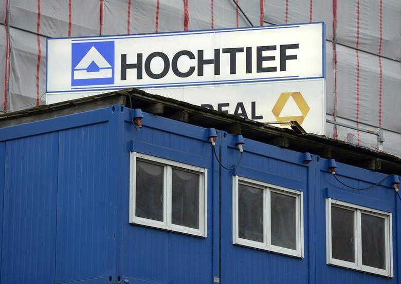 The logo of German construction company Hochtief is seen behind a container at the construction site for Elbphilharmonie (Philharmonic Hall), in downtown Hamburg, February 26, 2013. REUTERS/Fabian Bimmer