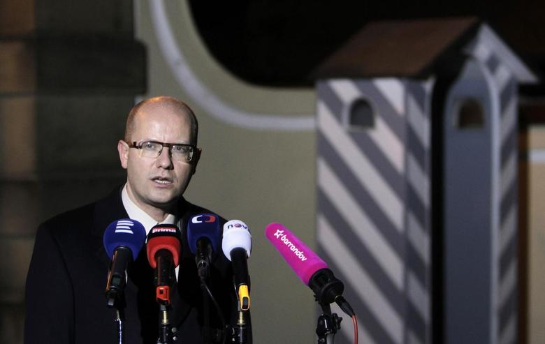 Czech Social Democratic Party (CSSD) leader Bohuslav Sobotka speaks to the media in front of the Lany chateau after meeting President Milos Zeman (not seen) in the village of Lany near Prague November 21, 2013. REUTERS/David W Cerny