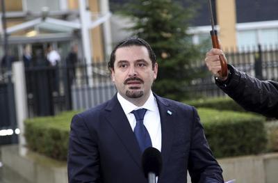 Lebanon's Hariri says could share power with Hezbollah