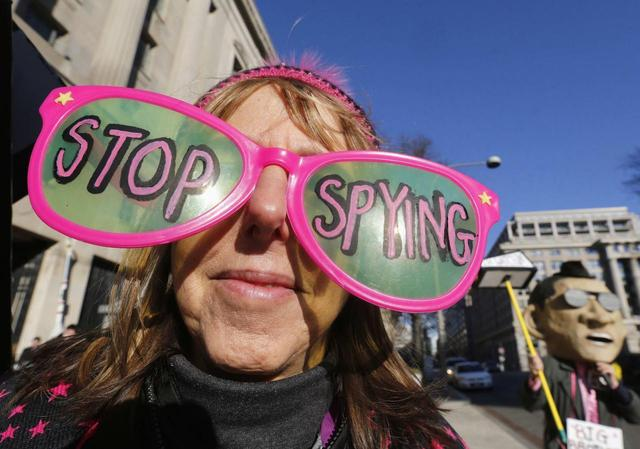 The founder of the protest group Code Pink Medea Benjamin wears large sunglasses as she protests against U.S. President Barack Obama and the NSA before his arrival at the Department of Justice in Washington, January 17, 2014. REUTERS/Larry Downing