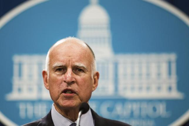 California Governor Jerry Brown unveils his proposed 2014-15 state budget in Sacramento, California, January 9, 2014. REUTERS/Max Whittaker