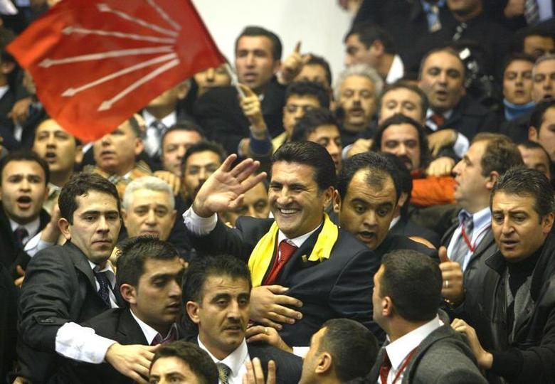Mustafa Sarigul, one of the two candidates for the leadership of the Turkey's main opposition Republican People's Party (CHP) waves to his supporters at the beginning of his party's 13th extraordinary congress gathered in Ankara, January 29, 2005, where the new leader of the party will be elected. REUTERS/Umit Bektas