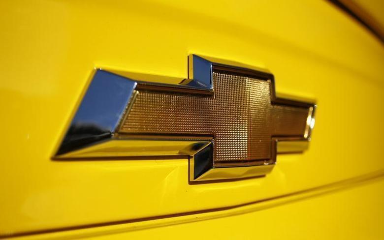 A Chevrolet logo is displayed on a vehicle at Courtesy Chevrolet dealership in Phoenix, Arizona, January 4, 2011. REUTERS/Joshua Lott