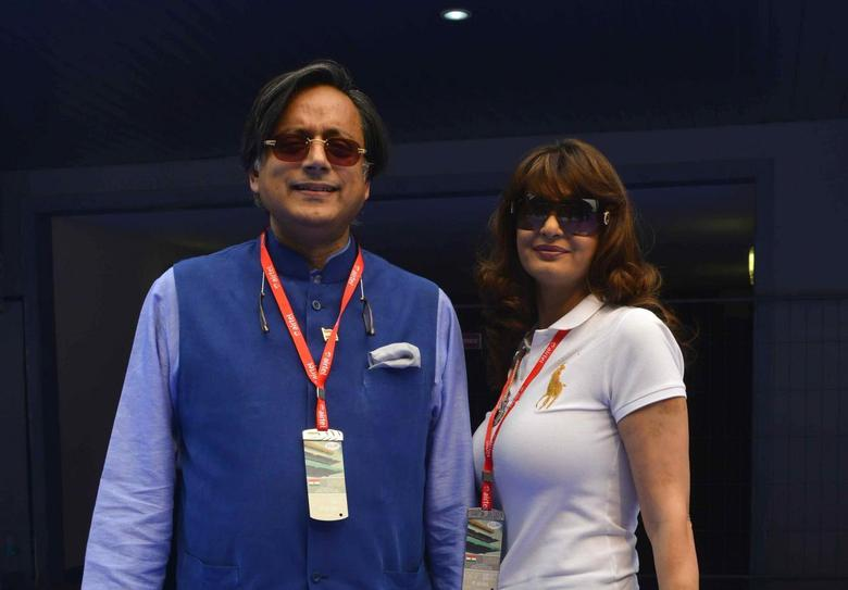 Sunanda Puskhar Tharoor (R), wife of India's Minister of State for Human Resource Development Shashi Tharoor, poses with her husband at the Indian F1 Grand Prix at the Buddh International Circuit in Greater Noida, on the outskirts of New Delhi, October 27, 2013. REUTERS/Stringer
