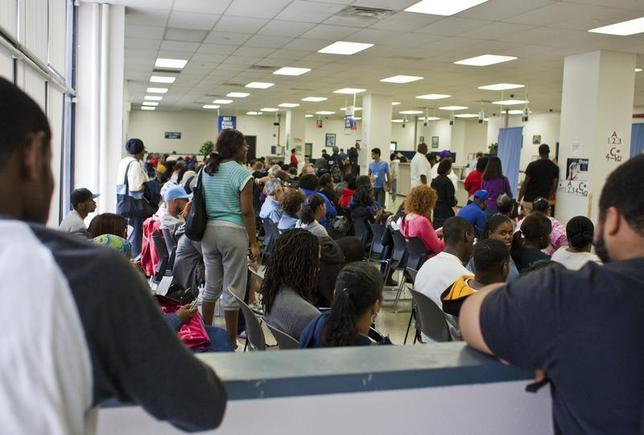 People fill the waiting area of a Pennsylvania Department of Transportation office in Philadelphia as they wait to get a voter ID card, September 27, 2012. REUTERS/Tom Mihalek