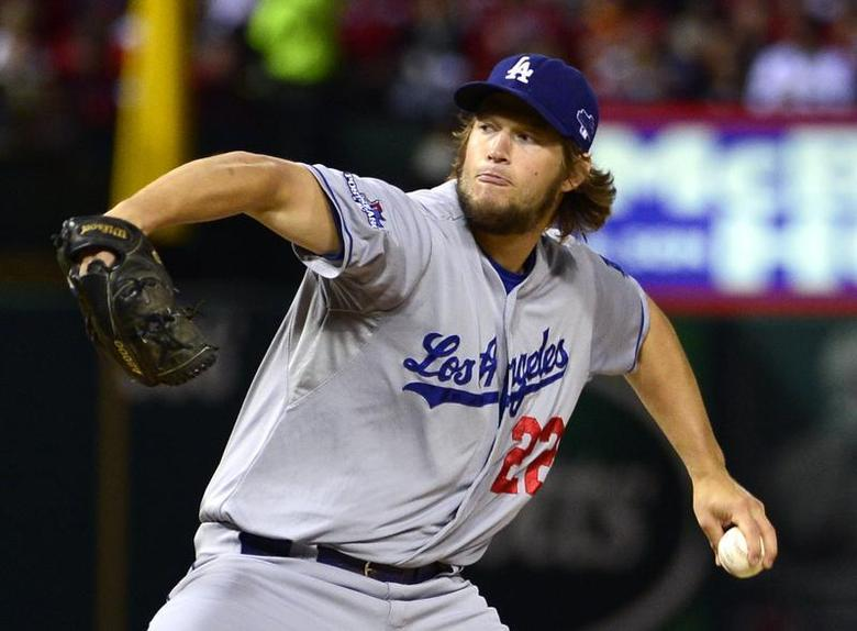 Los Angeles Dodgers starting pitcher Clayton Kershaw throws a pitch against the St. Louis Cardinals during the first inning in game six of the National League Championship Series baseball game at Busch Stadium. Scott Rovak-USA TODAY Sports