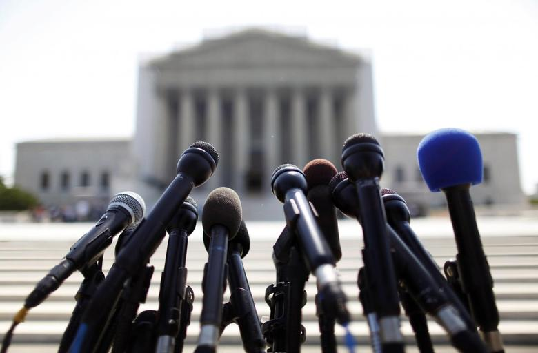 News microphones wait to capture reactions from U.S. Supreme Court rulings outside the court building in Washington, June 25, 2013. REUTERS/Jonathan Ernst
