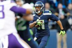 Nov 17, 2013; Seattle, WA, USA; Seattle Seahawks wide receiver Percy Harvin (11) returns a kickoff against the Minnesota Vikings during the second quarter at CenturyLink Field. Joe Nicholson-USA TODAY Sports