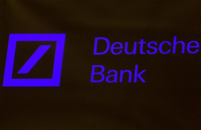 A Deutsche Bank sign is seen on the floor of the New York Stock Exchange January 15, 2014. REUTERS/Brendan McDermid