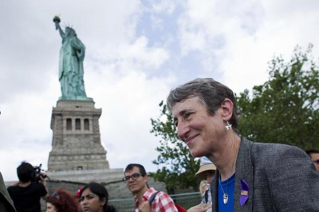 Secretary of the Interior Sally Jewell (R) takes a tour to the Statue of Liberty and Liberty Island during its reopening to the public in New York July 4, 2013. REUTERS/Eduardo Munoz