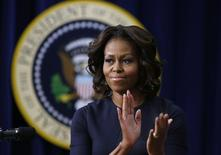 U.S. first lady Michelle Obama applauds as she gives remarks at an event on Expanding College Opportunity inside the Eisenhower Executive Office Building on the White House complex in Washington, January 16, 2014. REUTERS/Larry Downing