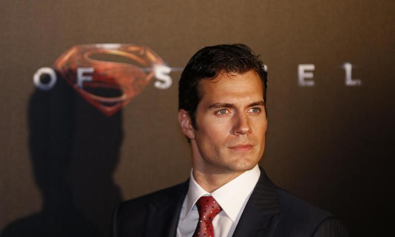 Cast member Henry Cavill poses for pictures after his arrival to the Australian premiere of ''Man of Steel'' in central Sydney June 24, 2013. REUTERS/Daniel Munoz