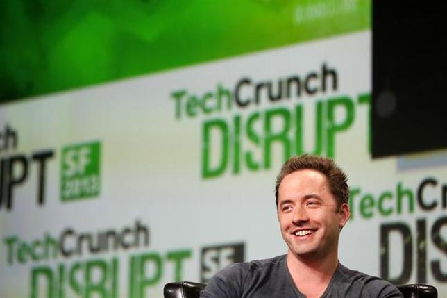 Drew Houston, CEO and Co-Founder of Dropbox, speaks on stage during a fireside chat session at TechCrunch Disrupt SF 2013 in San Francisco, California September 9, 2013. REUTERS/Stephen Lam/Files