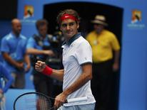 Roger Federer of Switzerland celebrates defeating Teymuraz Gabashvili of Russia during their men's singles match at the Australian Open 2014 tennis tournament in Melbourne January 18, 2014. REUTERS/David Gray