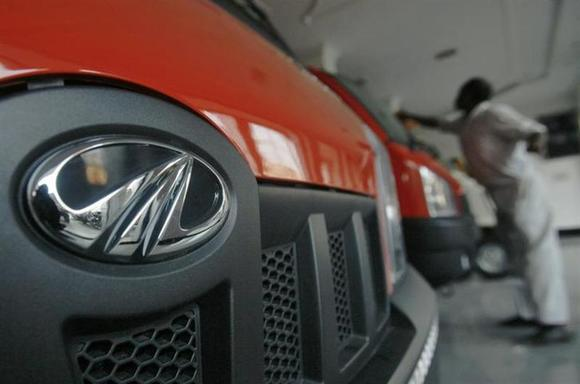A worker cleans a Mahindra vehicle inside the company's showroom on the outskirts of Agartala, November 26, 2012. REUTERS/Jayanta Dey/Files