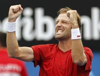 Stephane Robert of France celebrates defeating Martin Klizan of Slovakia during their men's singles match at the Australian Open 2014 tennis tournament in Melbourne January 18, 2014. REUTERS/Brandon Malone