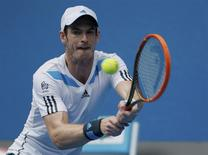 Andy Murray of Britain hits a return to Feliciano Lopez of Spain during their men's singles match at the Australian Open 2014 tennis tournament in Melbourne January 18, 2014. REUTERS/Jason Reed