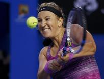 Victoria Azarenka of Belarus plays a shot during her women's singles match against Yvonne Meusburger of Austria at the Australian Open 2014 tennis tournament in Melbourne January 18, 2014. REUTERS/David Gray