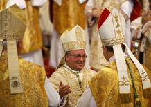 Newly-ordained Auxiliary Bishop of Malta Monsignor Charles Scicluna (C) is congratulated by fellow bishops during his ordination ceremony at St John's Co-Cathedral in Valletta November 24, 2012 in this file picture. REUTERS/Darrin Zammit Lupi