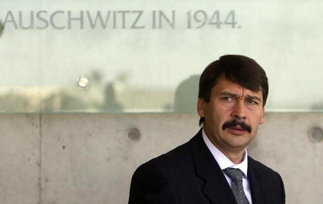 Hungary's President Janos Ader pauses after signing the guest book at Yad Vashem Holocaust memorial in Jerusalem July 17, 2012. REUTERS/Ronen Zvulun