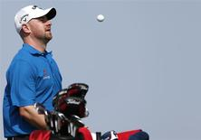 Craig Lee of Scotland plays with the ball on the third hole during the Abu Dhabi Golf championship January 18, 2014. REUTERS/Ahmed Jadallah