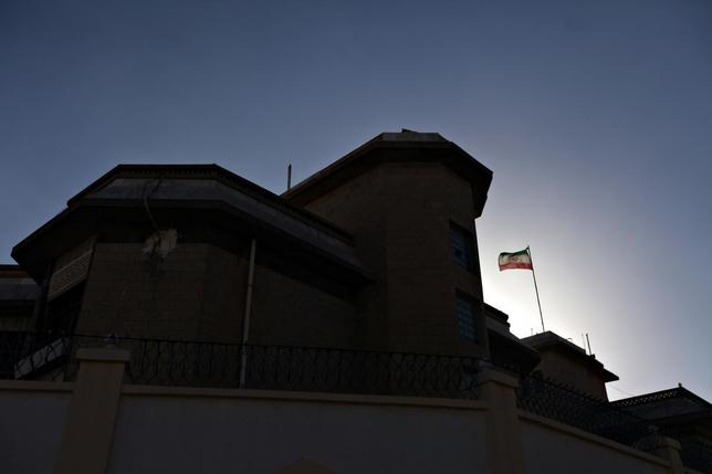 A Iranian flag flutters in the winds at the Iranian ambassador's residence in Sanaa January 18, 2014. REUTERS/Mohamed al-Sayaghi