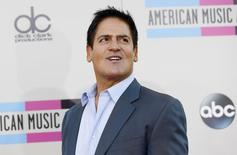 Dallas Mavericks NBA basketball team owner Mark Cuban arrives at the 41st American Music Awards in Los Angeles, California November 24, 2013 file photo. REUTERS/Mario Anzuoni