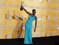 "Actress Lupita Nyong'o poses with her award for outstanding performance by a female in a supporting role for her role in ""12 Years a Slave"" at the 20th annual Screen Actors Guild Awards in Los Angeles, California January 18, 2014. REUTERS/Lucy Nicholson"