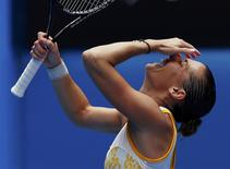 Flavia Pennetta of Italy celebrates defeating Angelique Kerber of Germany during their women's singles match at the Australian Open 2014 tennis tournament in Melbourne January 19, 2014. REUTERS/Petar Kujundzic