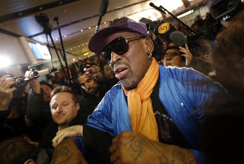 Retired U.S. basketball star Dennis Rodman is surrounded by journalists upon his arrival from North Korea's Pyongyang at Beijing Capital International Airport in this file photo taken January 13, 2014. REUTERS/Kim Kyung-Hoon/Files