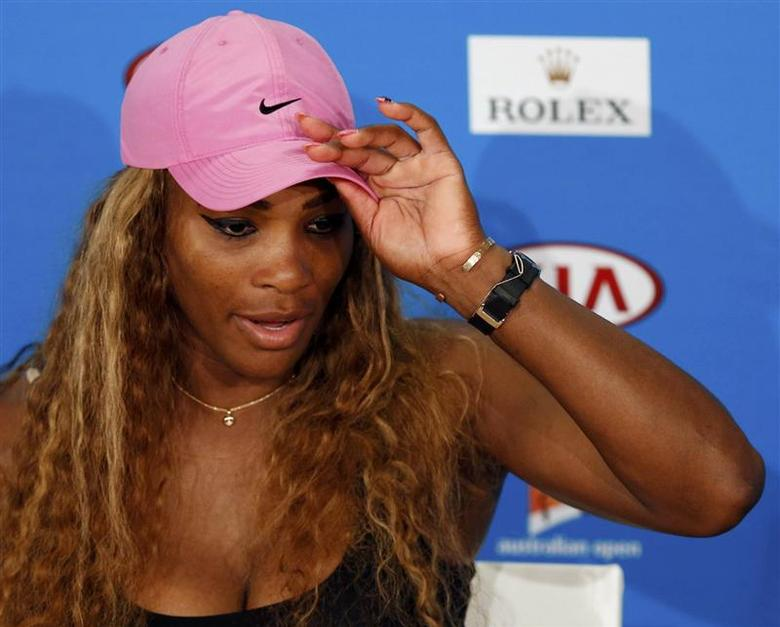 Serena Williams of the U.S. adjusts her cap during a news conference after being defeated by Ana Ivanovic of Serbia in their women's singles match at the Australian Open 2014 tennis tournament in Melbourne January 19, 2014. REUTERS/Bobby Yip