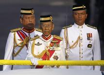 Malaysia's King Abdul Halim Mu'adzam Shah (C) leaves the podium to inspect an honour guard during the king's birthday parade in Kuala Lumpur June 2, 2012. REUTERS/Bazuki Muhammad