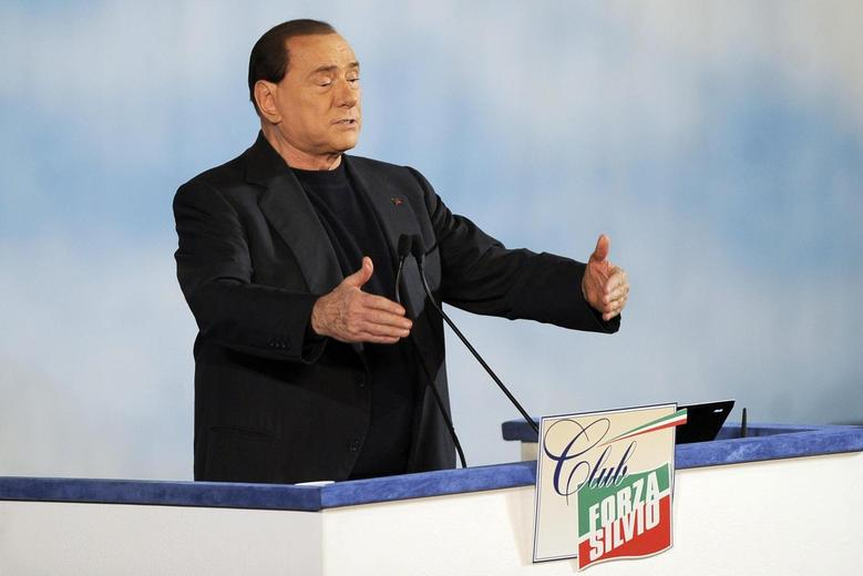 Former Italian Prime Minister Silvio Berlusconi reacts as he attends a rally to launch the ''Forza Silvio'' (Go Silvio) club in downtown Rome December 8, 2013. REUTERS/Yara Nardi