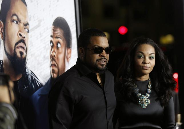 Cast member Ice Cube and his wife Kimberly Woodruff pose at the premiere of ''Ride Along'' at the TCL Chinese theatre in Hollywood, California January 13, 2014. REUTERS/Mario Anzuoni